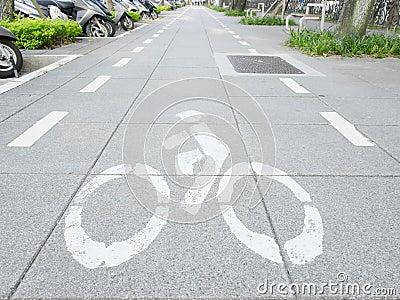 Bicycle mark on sidewalk