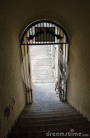 Bicycle parked below the stairs
