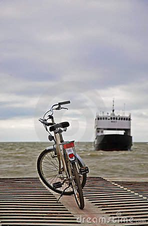 Bicycle waiting for small ferry-boat