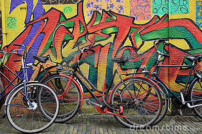 Bicycles leaned against wall