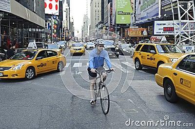 Bicyclist riding through midtown Editorial Image