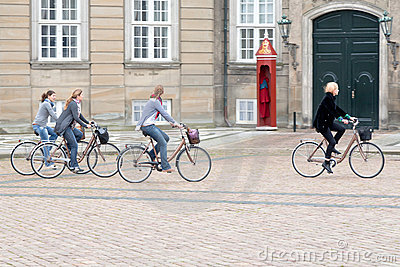 Bicyclists on square in Amalienborg Palace Editorial Photo