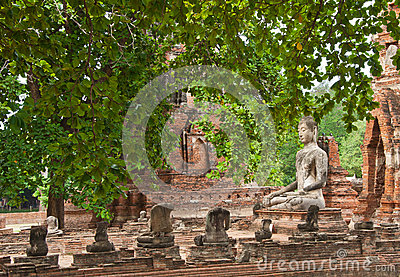 The big ancient buddha statue in ruined old temple