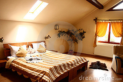 Big bed in a hotel room at the attic