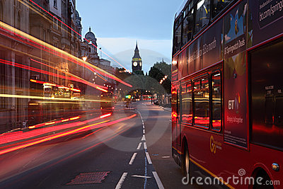 Big Ben and buses at dawn in London city England Editorial Stock Photo