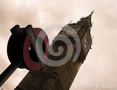 Big Ben tower and the sign of the London Underground against a cloudy sky Editorial Stock Photo