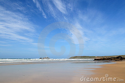 A big blue sky and sea.