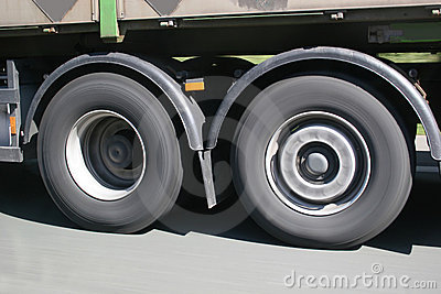 Big blurred lorry wheels on the move
