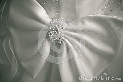 Big bow on a wedding dress. simple background.