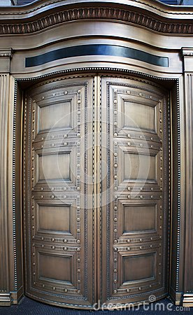 Big Brass Revolving Bank Doors up close