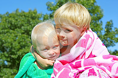 Big Brother Hugging Baby Outside