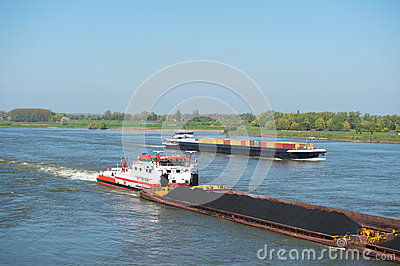Big cargo ships in Dutch landscape