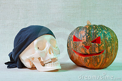 The big cheerful halloween pumpkin and skull