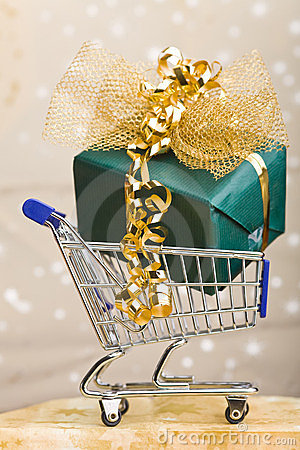 Big christmas gift in shopping cart