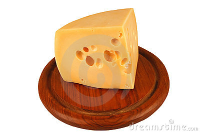 Big chunk of yellow cheese on wood