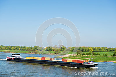 Big container ship in Dutch landscape