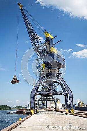Big crane in the city river port