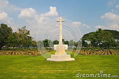 Big cross and gravestones on cemetery