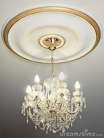 Big electric chandelier on ceiling