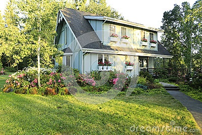 big farmhouse with beautiful flowerbed stock photography country house and home plans at eplans com includes