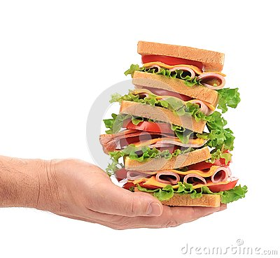 Big fresh sandwich in hands.