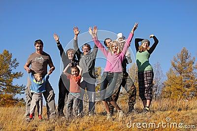 Big happy family in autumn park 2