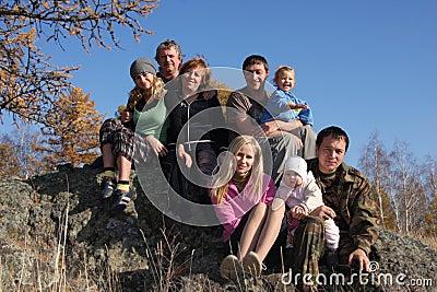 Big happy family in autumn park
