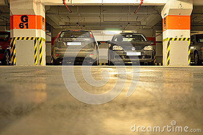 Car parking places inside underground parking Editorial Stock Photo