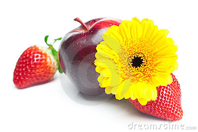 Big juicy red ripe strawberries,flower and apple