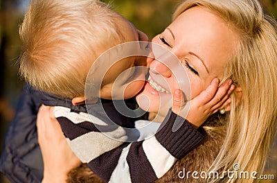 Big kiss for mom.