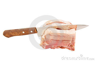 Big kitchen knife and raw pork isolated