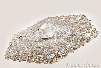 Big lacy tablecloth and cup