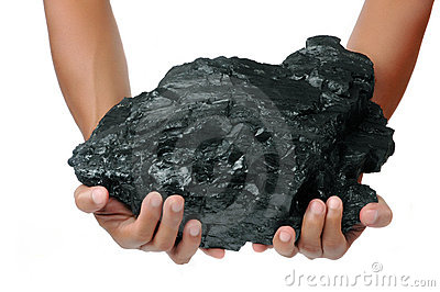A big lump of coal is held with two hands