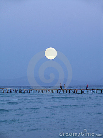 Big moon over pier