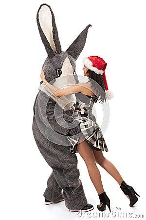 Big rabbit flirting with cute girl
