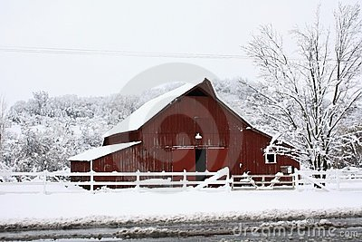 Big red barn in the snow.
