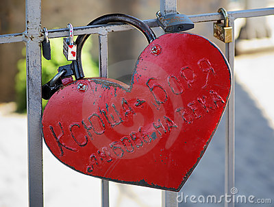 A big red heart-shaped padlock