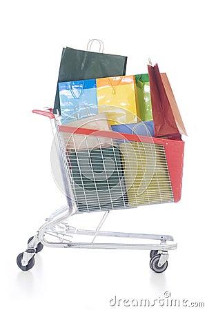 Big red shopping cart full of shopping bags