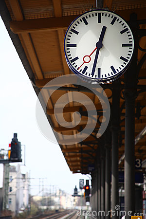 Big round outdoor clock at a railway station