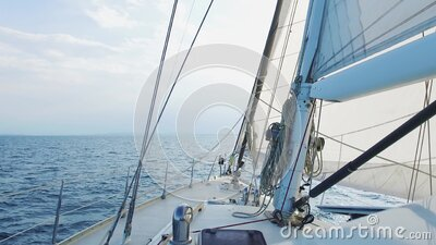 Sailing yacht boat driving thru the ocean on a sunny day stock video footage