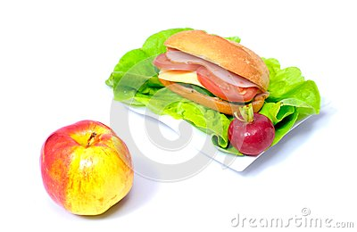 Big sandwich and a ripen apple