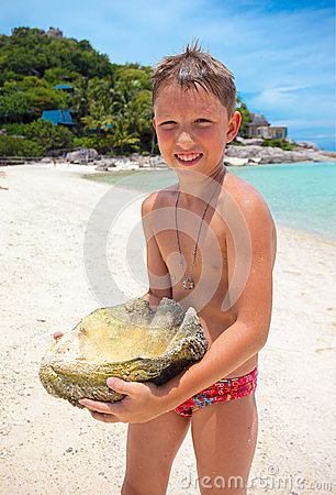 Big Seashell Held by a Young Boy