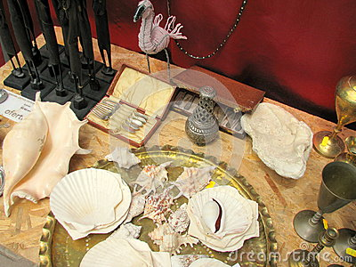 Big shells and antiquities for sale in a flea market Editorial Stock Photo