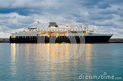 Big ship at night pier