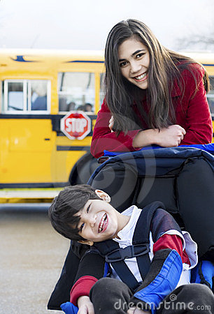 Free Big Sister With Disabled Brother At School Stock Photo - 23477760