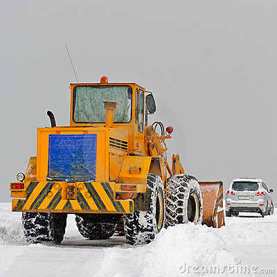 Big snowplow clearing road