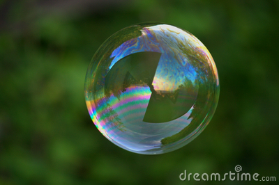 Big soap bubble on green