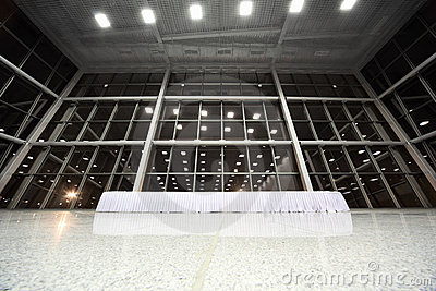 Big table covered with white tablecloth in lobby