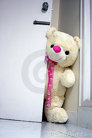 Big Teddy Bear Opening the Door