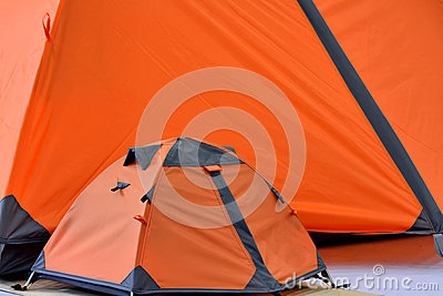Big tent and small tent in orange